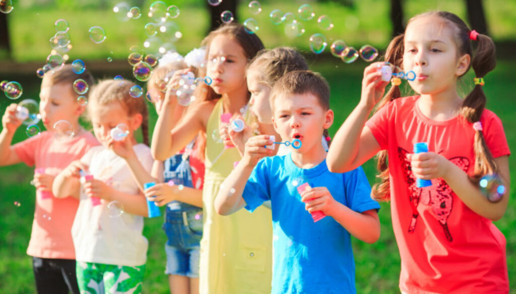 group-children-blowing-soap-bubbles_109285-4477